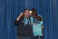 Adebayo Akinfenwa is unveiled as a new Wycombe player  & poses with a supporter during the Wycombe Wanderers 2016/17 Kit launch to the Public at Adams Park, High Wycombe, England on 10 July 2016. Photo by Andy Rowland.