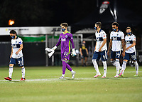 LAKE BUENA VISTA, FL - JULY 26: Russell Teibert of Vancouver Whitecaps FC, Thomas Hasal of Vancouver Whitecaps FC and teammates take the field during a game between Vancouver Whitecaps and Sporting Kansas City at ESPN Wide World of Sports on July 26, 2020 in Lake Buena Vista, Florida.
