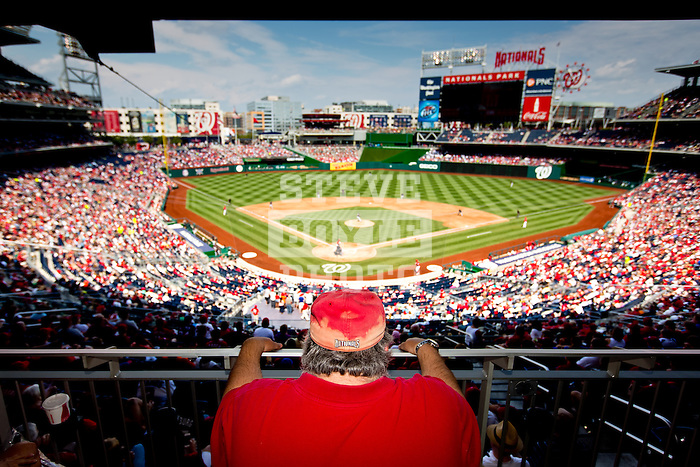 A Washington Nationals fan shows watches the game from behind home plate at Nationals Park in Washington, DC on September 8, 2012.