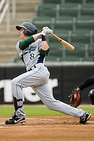 Andrew Simunic #8 of the Lexington Legends follows through on his swing against the Kannapolis Intimidators at Fieldcrest Cannon Stadium April 14, 2010, in Kannapolis, North Carolina.  Photo by Brian Westerholt / Four Seam Images