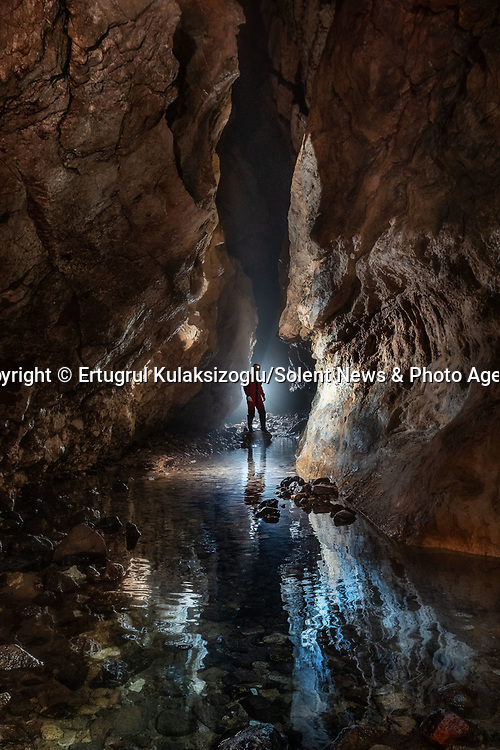 Pictured:  Sarpunalınca Cave, Kastamonu, Turkey.<br /> <br /> A team of explorers venture through a series of incredible caves filled with huge stalagmites and underwater lakes.<br /> <br /> The adventurers are carrying out tests in the subterranean world to work out how old the caves are and how they were formed.<br /> <br /> The intriguing images were captured in caves across Turkey by amateur photographer Ertuğrul Kulaksizoglu.   SEE OUR COPY FOR FULL DETAILS.<br /> <br /> <br /> Please byline: Ertugrul Kulaksizoglu/Solent News<br /> <br /> © Ertugrul Kulaksizoglu/Solent News & Photo Agency<br /> UK +44 (0) 2380 458800