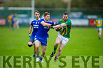 Lispole's Darren O'Cearúil been tackled by Shane Foley of   Annascaul in the West Kerry Football Championship.