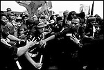 Summer '99-- Jakarta, Indonesia -- Security guards push back the crowd during a rally for Megawati. Political life is tough on the world's most inhabited island in the world's biggest muslim nation.