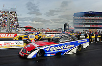 Sept. 5, 2011; Claremont, IN, USA: NHRA funny car driver Bob Tasca III (near lane) races alongside Ron Capps during the US Nationals at Lucas Oil Raceway. Mandatory Credit: Mark J. Rebilas-