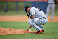 GCL Marlins relief pitcher Chevis Hoover (39) writes in the dirt behind the mound during a game against the GCL Mets on August 3, 2018 at St. Lucie Sports Complex in Port St. Lucie, Florida.  GCL Mets defeated GCL Marlins 3-2.  (Mike Janes/Four Seam Images)