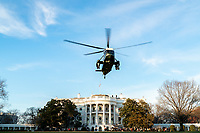 President Trump Departs for Florida<br /> <br /> President Donald J. Trump boards Marine One on the South Lawn of the White House Wednesday, Dec. 23, 2020, en route to Joint Base Andrews, Md. to begin his trip Palm Beach, Fla. (Official White House Photo by Tia Dufour)