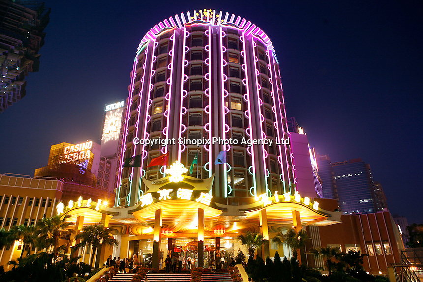 The Lisboa Hotel and casino at night in Macau. As restrictions on betting licences have become open to tender international Casino operators such as Wynn, Sands and MGM are making huge investements into Macau which is becomming the Vegas of the East and is driven by the massive Chinese gambling market on the former Portuguese colony's doorstep..