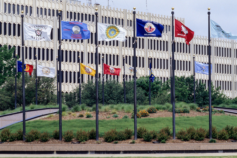 """Oklahoma City, Oklahoma, USA.  Oklahoma Indian Tribal Flags.  """"The Meeting Place"""", where all people may meet to honor our Native Americans.  State Capitol Grounds."""