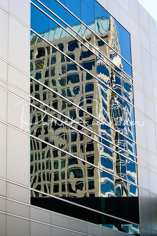 An office building is reflected in windows uptown Charlotte, NC.