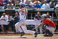 Florida Gators outfielder Ryan Larson (66) follows through on his swing against the Virginia Cavaliers in Game 11 of the NCAA College World Series on June 19, 2015 at TD Ameritrade Park in Omaha, Nebraska. The Gators defeated Virginia 10-5. (Andrew Woolley/Four Seam Images)