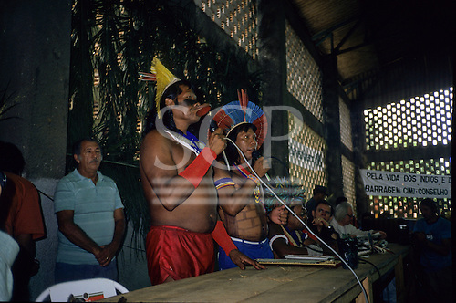 Altamira, Brazil. Protest against the proposed Kararao (later Belo Monte) hydroelectric dam staged by the Kayapo and other tribal Indian groups. The protest weas successful in persuading the World Bank to withdraw finance for the project. Paulinho Payakan (Bep Koroti Kayapo) and Raoni Txucarramae, the principal proponents of the protest.