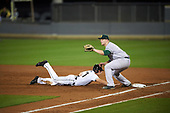 Siena Saints first baseman Joe Drpich (47) waits for a pickoff attempt throw as Brennan Bozeman (21) dives back to the bag during a game against the UCF Knights on February 17, 2017 at UCF Baseball Complex in Orlando, Florida.  UCF defeated Siena 17-6.  (Mike Janes/Four Seam Images)