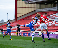 2nd April 2021, Oakwell Stadium, Barnsley, Yorkshire, England; English Football League Championship Football, Barnsley FC versus Reading; Lewis Gibson of Reading challenges with Michał Helik of Barnsley