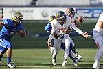 An unidentified Reed defender knocks the ball loose from the hands of Bishop Gorman's Issac Alcaraz in the second half of the NIAA 4A state championship football game in Reno, Nev., on Saturday, Dec. 2, 2017. Gorman won 48-7. Cathleen Allison/Las Vegas Review Journal @NVMomentum