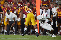 LOS ANGELES, CA - SEPTEMBER 11: Zahran Manley #31 of the Stanford Cardinal attempts to tackle Keaontay Ingram #28 of the USC Trojans during a game between University of Southern California and Stanford Football at Los Angeles Memorial Coliseum on September 11, 2021 in Los Angeles, California.