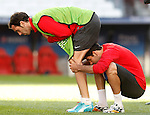 Atletico de Madrid's Diego Godin (l) and Diego Costa during training session previous to the UEFA Champions League 2013/2014 Final match.May 23,2014. (ALTERPHOTOS/Acero)