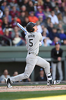 Center fielder TJ Hopkins (5) of the South Carolina Gamecocks bats in the Reedy River Rivalry game against the Clemson Tigers on Saturday, March 3, 2018, at Fluor Field at the West End in Greenville, South Carolina. Clemson won, 5-1. (Tom Priddy/Four Seam Images)