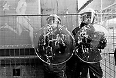 Brussels, Belgium.April 24, 2002..Protesters demonstrating against Jean-Marie Le Pen who visited the European Parliament in Brussels spray police guarding the Parliament with whipped cream.