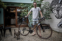 Belgian top custom bike mechanic Vince Van Parijs of Peloton de Paris (Mechelen) assembles a custom Ridley Kanzo gravel bike & is being checked upon by Trixie, the shop dog.<br /> <br /> ©kramon
