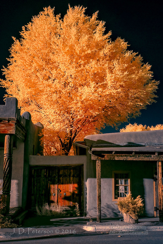 Wooden Door, Taos, New Mexico (Infrared) ©2016 James D Peterson.  An iconic scene in a frontier town comes alive on a late summer afternoon.  The unreal colors of this infrared image bring a new light to these classic buildings.