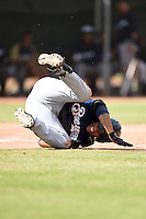 Milwaukee Brewers outfielder Johnny Davis (1) reacts to fouling a pitch off himself during an Instructional League game against the Los Angeles Angels of Anaheim on October 9, 2014 at Tempe Diablo Stadium Complex in Tempe, Arizona.  (Mike Janes/Four Seam Images)