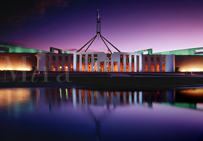 Parliament House on Capitol Hill with 4 legged flag mast at twilight Canberra Australia