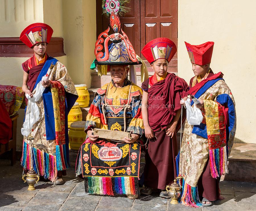 Nepal, Kathmandu, Swayambhunath.  Young Tibetan Buddhist Monks Assisting Senior Monk in a ceremony.