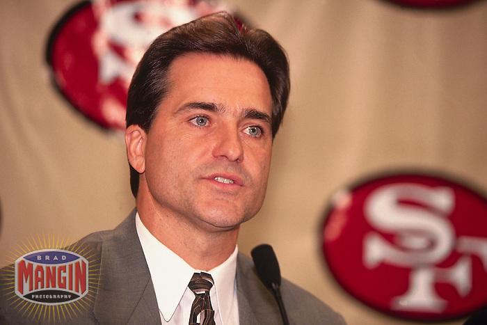 SANTA CLARA, CA - New head coach Steve Mariucci of the San Francisco 49ers is introduced to the media at the 49ers facility in Santa Clara, California in 1997. Photo by Brad Mangin