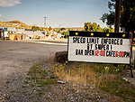 """Sign: """"Speed Limit Enforced by Sniper! Bar Open...""""Mt.City, Elko County, Nev."""