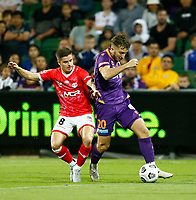 18th April 2021; HBF Park, Perth, Western Australia, Australia; A League Football, Perth Glory versus Wellington Phoenix; Carlo Armiento of the Perth Glory goes past the tackle of Cameron Devlin of Wellington Phoenix
