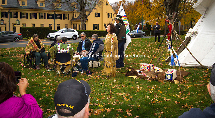MIDDLEBURY, CT - 05 NOVEMBER 2016 - 110516JW01.jpg -- Sandi Lyons, Dave Lyons, Mike Vaitkus, Chris Fagan, and Dave Northway perform on drum for Nancy Deer With Horns as she sings while her husband Wendell Deer With Horns blesses the group during the opening ceremony of the Native Indian Veterans Blessing on the Middlebury Town Green Saturday afternoon.    Jonathan Wilcox Republican-American