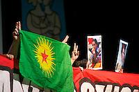 """Am Samstag den 12. Januar 2013 fand in der Berliner Urania die 18. Rosa-Luxemburg Konferen der Tageszeitung """"junge Welt"""" statt.<br />Im Bild: Unterstuetzer der kurdischen Organisation PKK protestieren waehrend der Konferenz gegen die Ermordung von 3 PKK-Frauen in Paris am 10. Januar 2013. Die Frauen gehoerten zur Fuehrung der PKK und wurden von Unbekannten offensichtlich hingerichtet.<br />12.1.2013, Berlin<br />Copyright: Christian-Ditsch.de<br />[Inhaltsveraendernde Manipulation des Fotos nur nach ausdruecklicher Genehmigung des Fotografen. Vereinbarungen ueber Abtretung von Persoenlichkeitsrechten/Model Release der abgebildeten Person/Personen liegen nicht vor. NO MODEL RELEASE! Don't publish without copyright Christian-Ditsch.de, Veroeffentlichung nur mit Fotografennennung, sowie gegen Honorar, MwSt. und Beleg. Konto:, I N G - D i B a, IBAN DE58500105175400192269, BIC INGDDEFFXXX, Kontakt: post@christian-ditsch.de<br />Urhebervermerk wird gemaess Paragraph 13 UHG verlangt.]"""