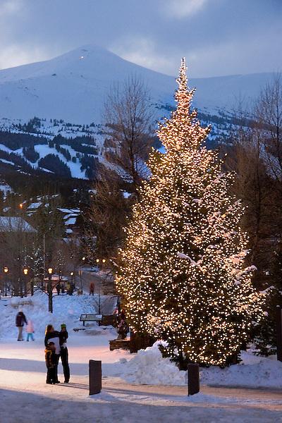 Mother and children view Christmas tree, Breckenridge Ski Area, Colorado,