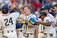 Michigan Wolverines first baseman Jimmy Kerr (15) celebrates after hitting a home run in the seventh inning against the Vanderbilt Commodores during Game 1 of the NCAA College World Series Finals on June 24, 2019 at TD Ameritrade Park in Omaha, Nebraska. Michigan defeated Vanderbilt 7-4. (Andrew Woolley/Four Seam Images)