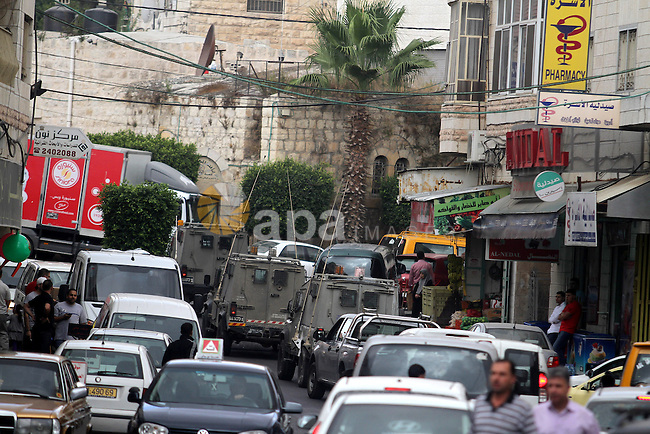 Israeli security vehicles patrol streets in the West Bank city of Ramallah, on Sept. 23, 2013. following the death of an Israeli soldier after he was shot by a suspected Palestinian gunman. The shooting took place close to the volatile Cave of the Patriarchs, which is considered holy to both Jews and Muslims. Photo by Issam Rimawi