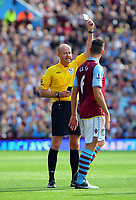 Saturday 15 September 2012<br /> Pictured: Ciaran Clark of Aston Villa (R) is shown a yellow card by match referee L Mason (L).<br /> Re: Barclay's Premier League, Aston Villa v Swansea City FC at Villa Park, West Midlands, UK.