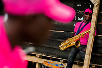An Afro-Colombian saxophone player waits for the start of a boat convoy during the San Pacho festival in Quibdó, Colombia, 3 October 2019. Every year at the turn of September and October, the capital of the Pacific region of Chocó holds the celebrations in honor of Saint Francis of Assisi (locally named as San Pacho), recognized as Intangible Cultural Heritage by UNESCO. Each day carnival groups, wearing bright colorful costumes and representing each neighborhood, dance throughout the city, supported by brass bands playing live music. The festival culminates in a traditional boat ride on the Atrato River, followed by massive religious processions, which accent the pillars of Afro-Colombian's identity – the Catholic devotion grown from African roots.