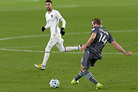 ST PAUL, MN - OCTOBER 28: Brent Kallman #14 of Minnesota United FC passes the ball during a game between Colorado Rapids and Minnesota United FC at Allianz Field on October 28, 2020 in St Paul, Minnesota.