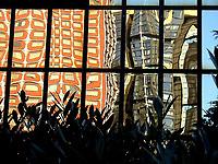 The reflected image of part of two different Parisian skyscraper that is twisted by a mirror wall, with some plants in front of it, in a play of contrasting colours and lights (Parigi, 2007).<br /> <br /> L'immagine riflessa di una parte di due diversi grattacieli Parigini, distorta da un muro a specchio, con alcune piante davanti, in un gioco di luce e colori contrastanti (Parigi, 2007).