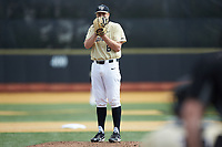 Wake Forest Demon Deacons starting pitcher Colin Peluse (8) looks to his catcher for the sign against the Louisville Cardinals at David F. Couch Ballpark on March 18, 2018 in  Winston-Salem, North Carolina.  The Demon Deacons defeated the Cardinals 6-3.  (Brian Westerholt/Four Seam Images)
