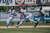19 July 2018: Vermont Lake Monsters catcher, playing at first this game, Robert Mullen (23) is chased by teammates after his his walk-off, game winning single in the bottom of the 9th inning to break a 1-1 ties with the Staten Island Yankees at Centennial Field in Burlington, Vermont. With 2 outs, and a full count, Mullen drove in Alfonso Rivas from third to give the Monsters their 2-1 NY Penn League win. Mandatory Credit: Ed Wolfstein Photo *** RAW (NEF) Image File Available ***