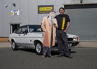 BNPS.co.uk (01202) 558833. <br /> Pic: MattRichardson/Classic Ford/BNPS<br /> <br /> Pictured: Tony Collins of Classic Car Restorations with the Capri and Arthur. <br /> <br /> The legendary Ford Capri that starred in '80s TV show Minder has been restored to its former glory after a devastating fire wrecked the car.<br /> <br /> The 1977 white motor which appeared on the opening titles of the comedy-drama caught ablaze while it was returning from an MoT test last year.<br /> <br /> It is thought an electrical fault in the engine bay caused the fire. <br /> <br /> Now a mechanic who specialises in classic car restorations has unveiled the famous Ford after fixing it up over the past six months.