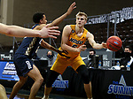 SIOUX FALLS, SD - MARCH 9: Sam Griesel #5 of the North Dakota State Bison passes the ball around Sheldon Stevens #23 of the Oral Roberts Golden Eagles during the 2021 Men's Summit League Basketball Championship at the Sanford Pentagon in Sioux Falls, SD. (Photo by Dave Eggen/Inertia)