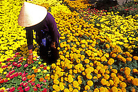 Woman in Straw Hat and Colorful Flowers. Vietnam, Mekong Delta