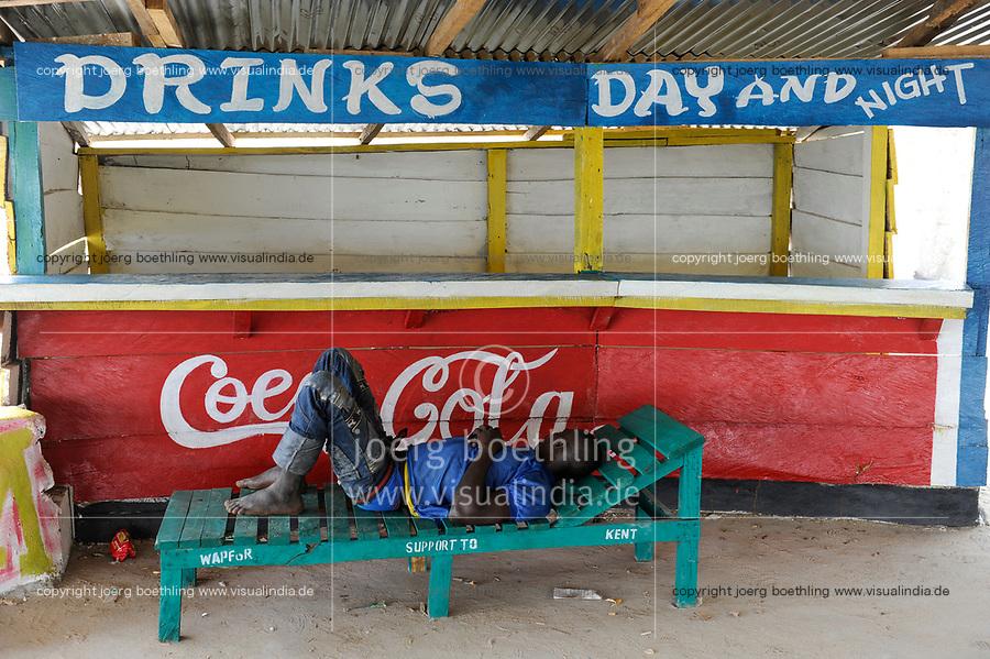 SIERRA LEONE Kent, beach at atlantic ocean, sleeping man at beach bar / SIERRA LEONE Kent, Strand am atlantischen Ozean, schlafender vor Strand Bar