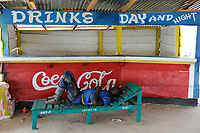 SIERRA LEONE Kent, beach at atlantic ocean, sleeping man at beach bar / SIERRA LEONE Kent, Strand am atlantischen Ozean, schlafender vor Strand Bar