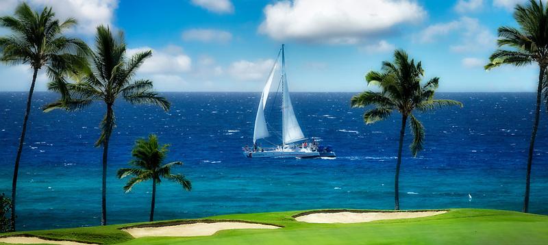 Sailboat and putting green. Hilton Waikoloa Beach Golf Resort. Hawaii, The Big Island