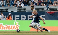 FOXBOROUGH, MA - JULY 27: Tesho Akindele #13 and Antonio Mlinar Delamea #19 battle for the ball during a game between Orlando City SC and New England Revolution at Gillette Stadium on July 27, 2019 in Foxborough, Massachusetts.