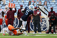 CHAPEL HILL, NC - OCTOBER 10: Dazz Newsome #5 of North Carolina breaks a tackle by Ny'Quee Hawkins #20 of Virginia Tech on his 12-yard touchdown reception run during a game between Virginia Tech and North Carolina at Kenan Memorial Stadium on October 10, 2020 in Chapel Hill, North Carolina.