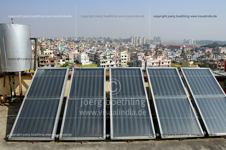 NEPAL Kathmandu, appartment building with solar collector for water heating / Haus mit Sonnenkollektor fuer Warmwasseraufbereitung
